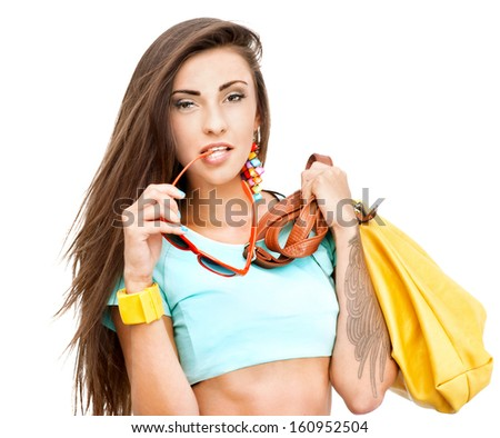 Portrait of beautiful young girl with yellow handbag against white background