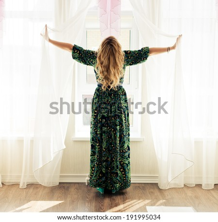 Portrait of beautiful young girls in the interior of the window  - stock photo