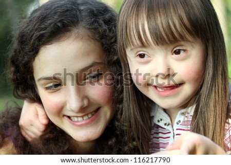 Portrait of beautiful young girls in the park. - stock photo
