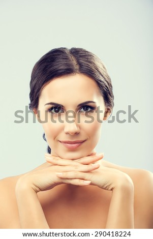 Portrait of beautiful young happy smiling brunette woman, with naked shoulders - stock photo