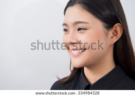 Portrait of beautiful young happy smiling woman. - stock photo