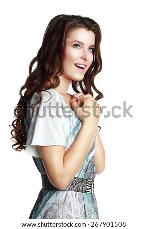 Portrait of beautiful young happy smiling woman with curly hair gesture