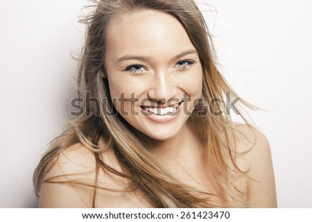 Portrait of beautiful young happy smiling woman with long hair, isolated over white background. studio shot - stock photo