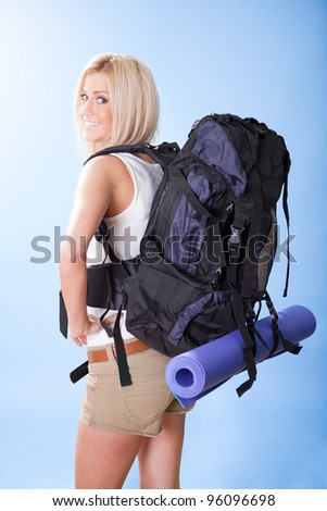 Portrait of beautiful young hiking woman with backpack - stock photo