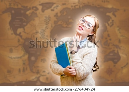 Portrait of beautiful young lady in glasses holding papers or books on old map background - stock photo