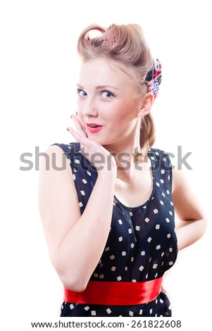 Portrait of beautiful young lady in polka dot dress with curlers looking surprised isolated on white background - stock photo