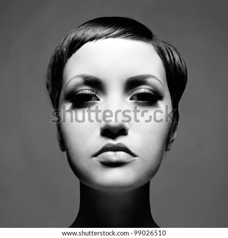 Portrait of beautiful young lady with short hair - stock photo