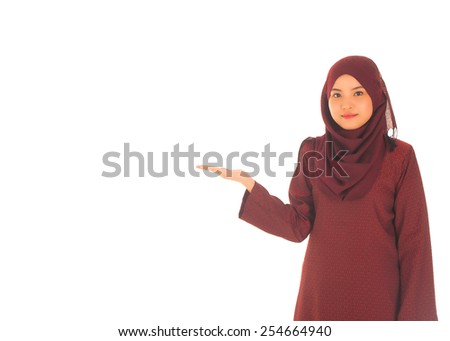 Portrait of beautiful young moslem woman presenting on white background - stock photo