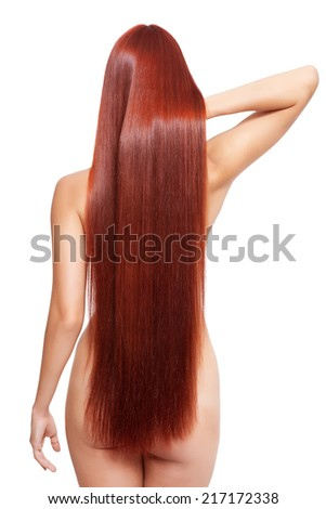 Portrait of beautiful young nude woman with long red hair isolated on white background. View from back side - stock photo