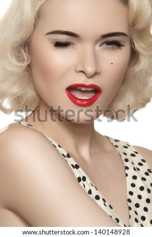 Portrait of beautiful young sexy woman with vintage make-up and hairstyle. Pin-up girl. American style - stock photo