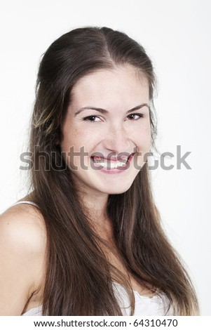 Portrait of beautiful young smiling girl with freckles, isolated on white background - stock photo