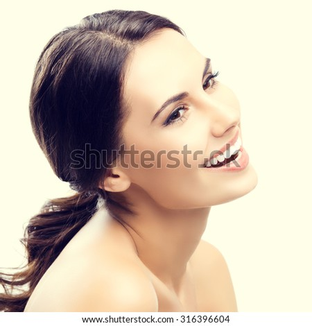 Portrait of beautiful young smiling woman - stock photo