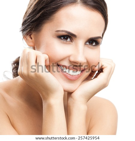 Portrait of beautiful young smiling woman, isolated against white background