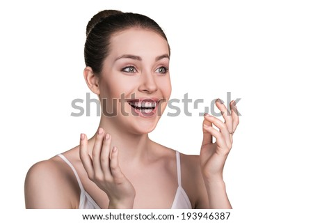 Portrait of beautiful young surprised woman isolated on white