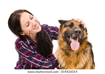 Portrait of beautiful young woman and a German Shepherd isolated on a white background - stock photo