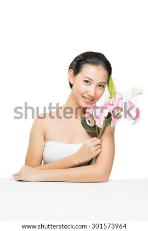Portrait of beautiful young woman. Beauty portrait of gorgeous fresh happy Asian girl smiling cheerful on white background. - stock photo