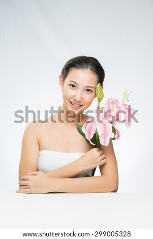 Portrait of beautiful young woman. Beauty portrait of gorgeous fresh smile happy Asian girl smiling cheerful on white background. - stock photo