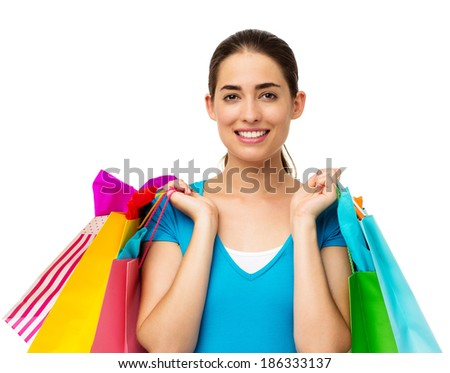 Portrait of beautiful young woman carrying shopping bags over white background. Horizontal shot.