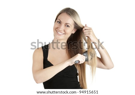 Portrait of beautiful young woman comb long straight hairs on white background - stock photo