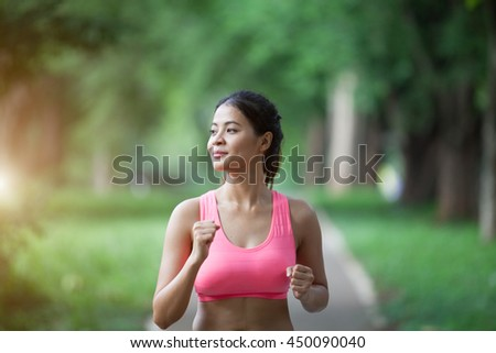 stock photo portrait of beautiful young woman doing exercise in the park she is very relaxed soft focus 450090040