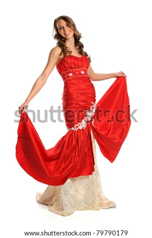 Portrait of beautiful young woman dressed in red evening gown isolated over white background