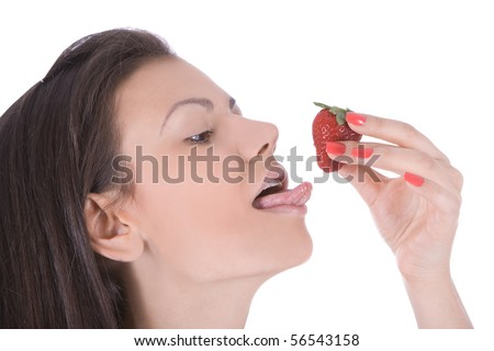 Portrait of beautiful young woman enjoy strawberry - stock photo