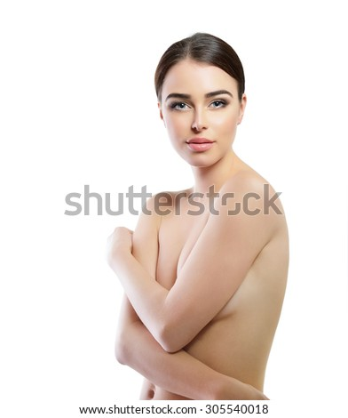 Portrait of beautiful young woman. Girl with perfect face, skin and body over white background.
