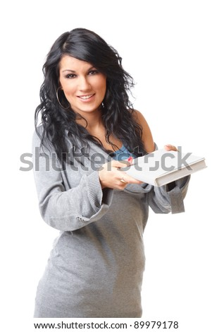 Portrait of Beautiful young woman giving the book on white background - stock photo