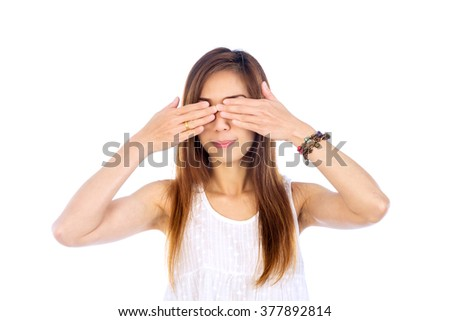 Portrait of beautiful young woman hands blindfolded, isolated on white background - stock photo