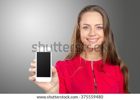 Portrait of beautiful young woman holding smartphone - stock photo