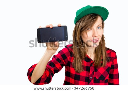 Portrait of beautiful young woman holding smartphone, focus on woman - stock photo