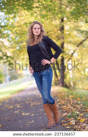 portrait of beautiful young woman in a park