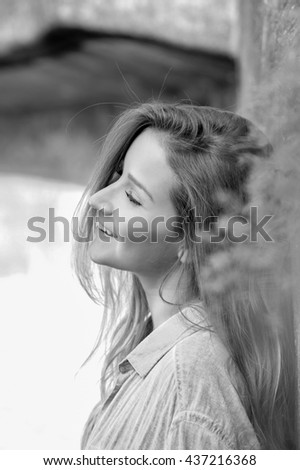 Portrait of beautiful young woman, in black and white - stock photo