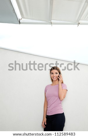 Portrait of beautiful young woman in casual wear talking on phone
