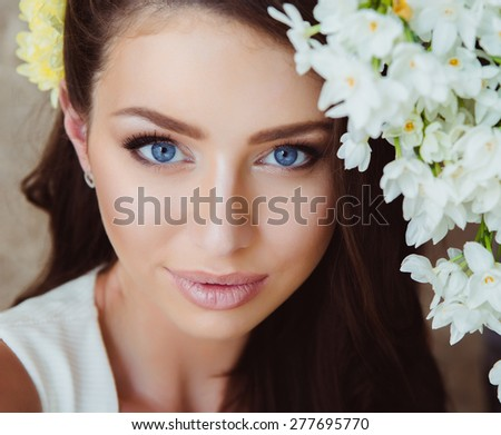 Portrait of Beautiful Young Woman in Flowers. Healthy Long Hair and Clear Skin. Close Up - stock photo