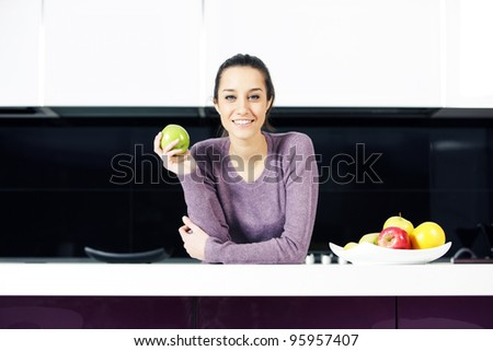 portrait of beautiful young woman in kitchen