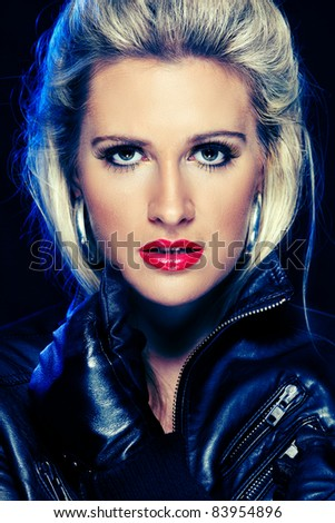 Portrait of beautiful young woman in leather jacket. Retouched