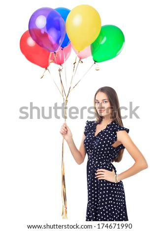 Portrait of beautiful young woman in polka dot dress with colorful balloons isolated on white background