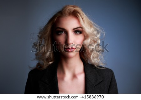 Portrait of beautiful young woman in Studio - stock photo