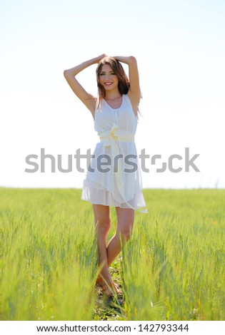 Portrait of beautiful young woman in the field