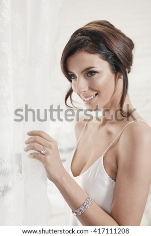 Portrait of beautiful young woman in white underwear. - stock photo