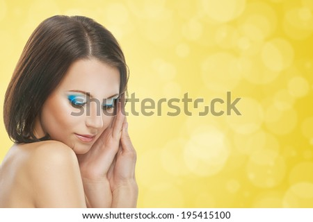 Portrait of beautiful young woman isolated on yellow background. - stock photo