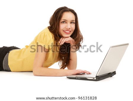 Portrait of beautiful young woman lying on floor with a laptop - isolated on white background