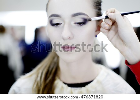 Portrait of beautiful young woman. Make up artist woman with bright makeup. Beauty concept