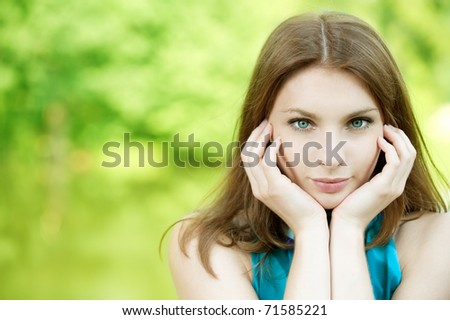 portrait of beautiful young woman on green background