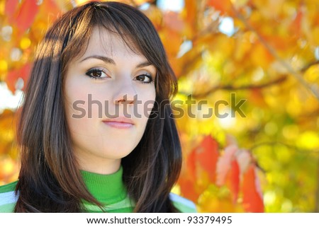 Portrait of beautiful young woman outdoors in autumn