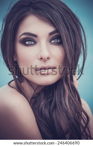 Portrait of beautiful young woman.  Outdoors.  Smoky eyes. Fashion colors. Cold sea - stock photo
