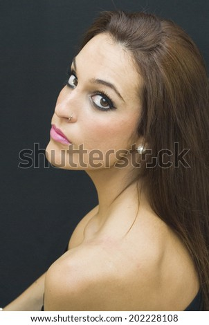 Portrait of Beautiful Young Woman Over Black Background