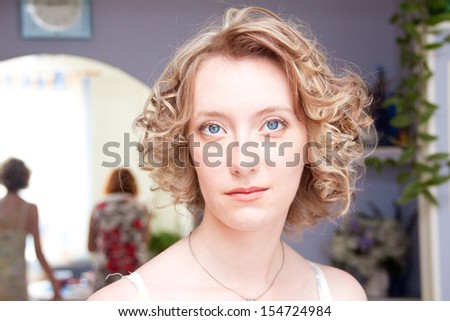 Portrait of beautiful young woman preparing for wedding - stock photo