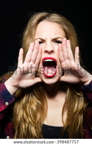 Portrait of beautiful young woman screaming. Isolated.